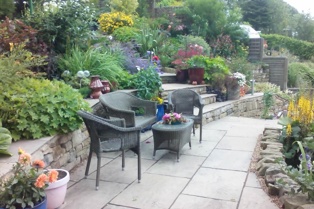 Landscape Creations – Exuberant planting to soften the stonework